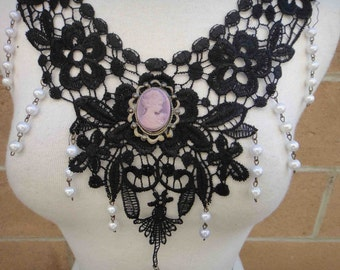 Beautiful black applique with beats hanging and a cameo buckle on the middle 1 piece listing