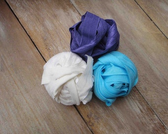 This listing is for 6 yards 2 of each color white purple blue