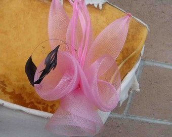 Cute  flower  applique pink   color with feather and  clip and pin back   1 piece listing