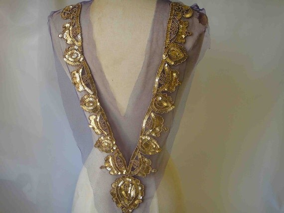 Big beaded peace of applique with gold sequence