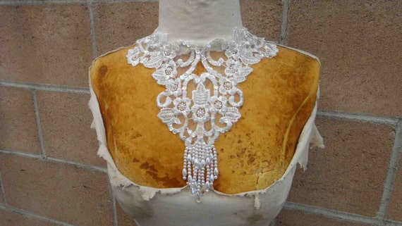 Ivory color beaded applique  ivory color 1 piece listing 11 inches wide at the neck 9 inches long from shoulder down 3 inch long beading