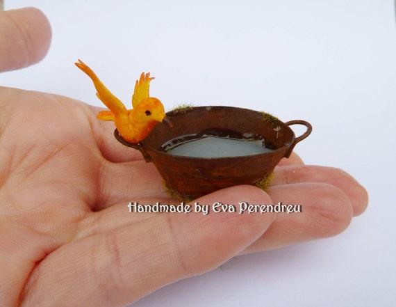 Miniature rusty tub with a landing bird for mini garden, dollhouse or terrarium