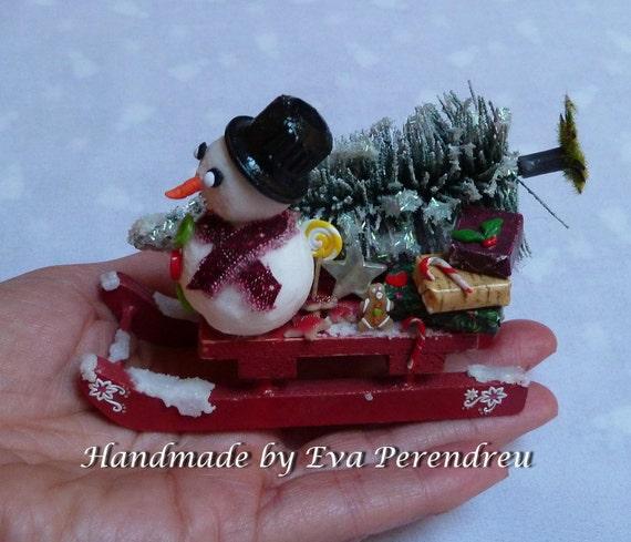 Miniature Christmas sledge with snowman, winter fantasy
