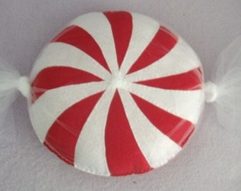 A Candy Swirl pillow with tule wrapper