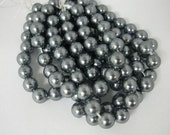 """An 8"""" strand of  dark grey color 12mm Rounds with a 2.5mm Drilled Hole mother of pearl"""
