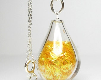 Yellow iridescent tinsel glitter in tear drop hand blown glass sterling silver pendant