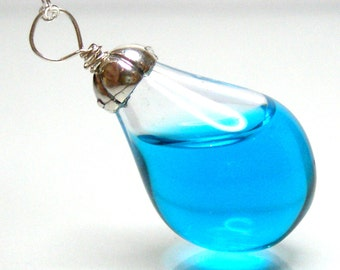 Sky blue color water in tear drop hand blown glass sterling silver necklace