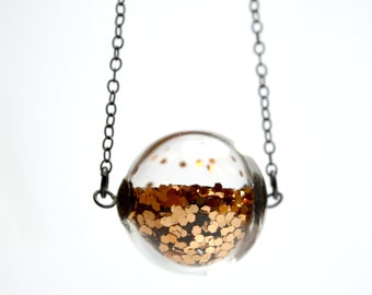 Copper glitter necklace in round hand blown glass necklace