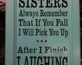 "Approx. 21"" x 18"" wooden Sisters sign with vinyl lettering,"