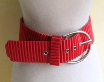 Fabulous Enormous metal buckled and red ribbed rubber belt Small Medium