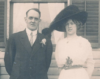 Woman with LARGE BLACK HAT and White Dress with Husband Photo Circa 1910