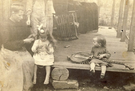 RESERVED FOR TOPKATGENERATION Toddler Holds Banjo While Her Mother Braids Her Sister's Hair Photo Postcard Circa 1910s