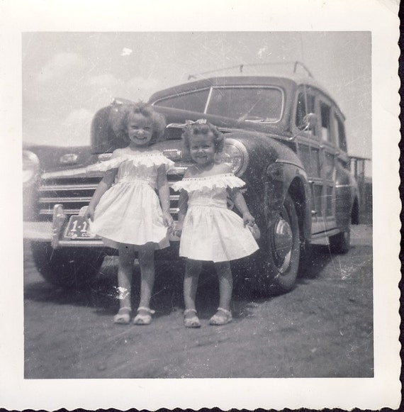 Two Little PRINCESSES  Showing Off Their MATCHING DRESSES In Front of the Family Woody Station Wagonto Circa 1940s