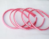 """5-1/2"""" plastic headband wrapped with pink satin ribbon. Just put your favorite flower."""