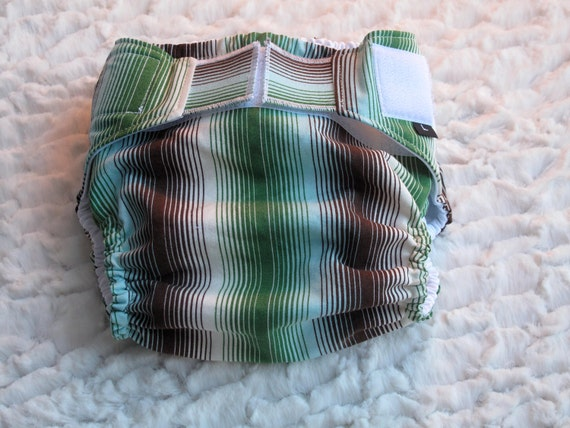 Diaper cover/ waterproof wrap. Brown, green and blue stripes. Size Large.