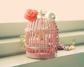 Golden bird inside pretty in pink cage necklace
