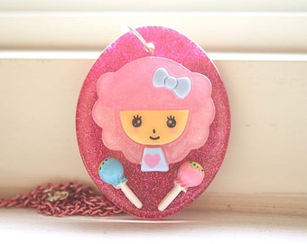 Pink hair girl with lollipops necklace