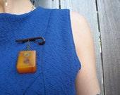 Upcycled handmade butterscotch Bakelite Mahjong tile brooch.