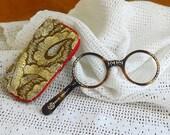 Fancy hand held reading glasses