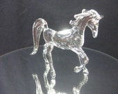 Glass prancing horse