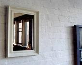 Bronze Mirror in Antique White Frame