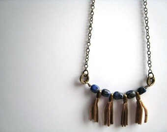 A Moveable Feast                         ..... lapis lazuli vintage brass tassle necklace . handmade . recycled . natural . original