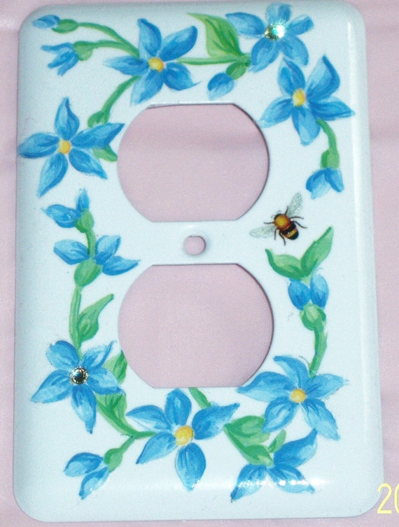Blue floral steel outlet cover - pale yellow swarovski crystals