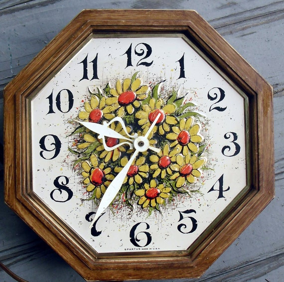 1970s Kitchen Retro Wall Clock with gold and orange daisies with green accent on faux bois octagon case