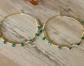 """Gold plated hammered 2"""" hoops with fire polished turquoise beads"""