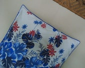 Large cool pillow in flowery blue sarong fabric with a royal blue trim 20 x 20