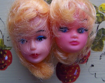 two vintage barbie doll heads