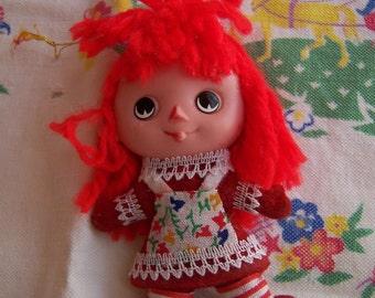 tiny plastic doll ornament