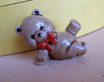 tiny bear with red bow figurine