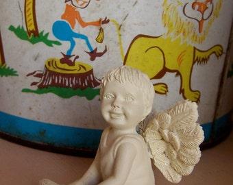 tiny cherub figurine