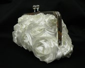 Stunning bridal clutch with ivory satin ribbon roses on ivory satin, with satin lining.  Made to order in colors of your choice.