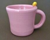 Pink mug with bird