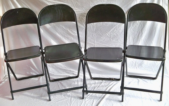 A Set of 4 Hampden Black Metal Folding Chairs Seat