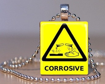 CORROSIVE - Acid Warning Sign Pendant or Tie Tack made from an Upcycled Scrabble Tile