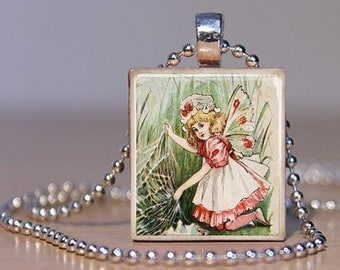 Vintage Child Fairy in Red and White - Pendant or Lapel Pin made from an Upcycled Scrabble Tile (87F4)