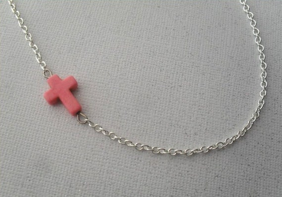 sideways pink cross necklace