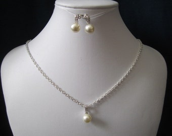 Elegant and classic pearl earrings with decorative cubic zirconia pendant and earrings