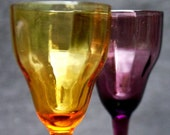 Two make a pair. Antique collectibles colored glasses.