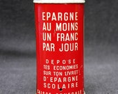 Save a dollar a day. Vintage red French money tin box.