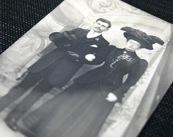 Mr and Mrs are going out. Antique couple black and white photography.