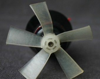 The little wind maker. Vintage mini fan ventilator.