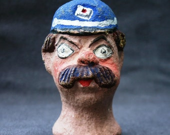 The policeman who lost his head. Vintage papier mache figurine.
