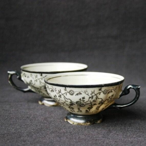 The two black cups. Pair of vintage porcelain teacups.