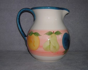 Hand painted peach, yellow, pink, green, teal, and cream ceramic pitcher from Portugal