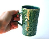 Green Ceramic Mug with Australian Flannel Flower Design