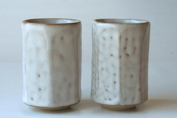 Pair of ceramic white drinking vessels